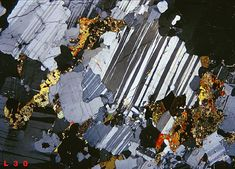 Labradorite  Thin section of a labradorite sample from Madagascar. The section is essentially occupied by plagioclase (Labrador). Some biotite is also present.