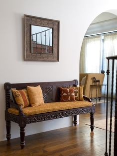 Awesome African Furniture to Create Charming African Interior Design: Adorable Mediterranean Living Room With Unique Couch Design As African Furniture Also Laminate Floor And Mirror With African Frame Style As African Decor Accent Also Lovely African Cushions ~ kaliopa.com Bedroom Design Inspiration