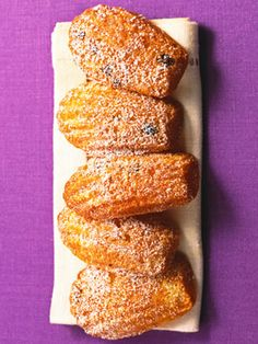 Madeleines are small sponge cakes baked in the shape of a shell. This simplified recipe starts with a box of yellow cake mix.