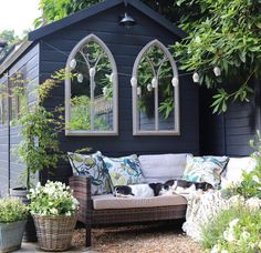The painted black shed and mirrors add a wonderful touch to the corner of this g. - The painted black shed and mirrors add a wonderful touch to the corner of this garden. Image: feather_and_faff_interiors Source by - Back Garden Design, Modern Garden Design, Backyard Garden Design, Small Backyard Landscaping, Backyard Ideas, Modern Design, Garden Design Ideas On A Budget, Backyard Patio, Small Garden Design With Shed