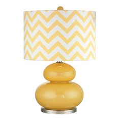 Fun contemporary 24 inch high glass table lamp with sunflower yellow finish and chevron patterned shade.