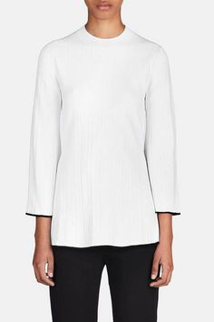 Proenza Schouler's Jack McCollough and Lazaro Hernandez modernized monochrome for spring, and this white crewneck brings together a flared hem, variegated ribbed texture, and contrast tipping to create a striking silhouette. Free of closures, the stretchy top has three-quarter-length sleeves: their bell shape accents the black tipping that is reprised at the swingy hem.
