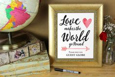 Love makes the world go round please sign our guest globe