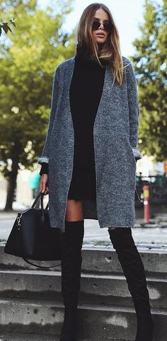 a black sweater dress a gray cardigan and black over the knee boots black