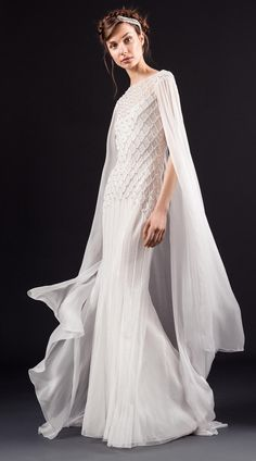 White caped gown with beading details   Temperley Spring 2017   https://www.theknot.com/content/temperley-wedding-dresses-bridal-fashion-week-spring-2017