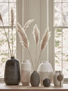 The bold silhouette design of our vase is created by a resistance glaze process to give it a raw surface.A artisanal stoneware vase to bring an poetic edge to a rusti Objet Deco Design, Living Room Decor, Bedroom Decor, Grass Decor, Deco Floral, White Vases, Plant Decor, Home Decor Vases, Home Decor Accessories