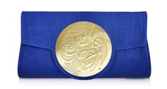 """This Dareen Hakim clutch is artfully inscribed with arabesque calligraphy that says """"LIVE AND LAUGH"""". Meticulously hand-engraved using 24K gold metals. Genuine Italian leather. 6 1/2"""" T x 12"""" W x 2"""" D. Bengaline lining in her signature color fuchsia. 5"""" Inner Pocket. Hidden Magnet Outer Closure. With their cool art-piece feel, these handbags have appealed to women with a taste for elegant, yet unique fashion statements.  $295…"""