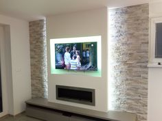 TV wall with stone facing – Wohnzimmer – fireplace tv wall modern Stone Wall Living Room, Home Design Living Room, Living Room Tv, Living Room With Fireplace, Fireplace Tv Wall, Fireplace Design, Fireplace Facing, Simple Fireplace, Fireplace Stone