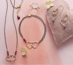 Open Hearts Necklace, Bracelet, Earrings, and Ring - Open hearts with one sterling silver, the other 14kt gold filled.