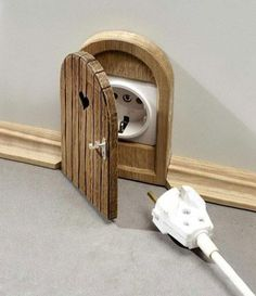 what a cute idea to hide ugly outlets!