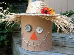 This Coffee Can Scarecrow is a great Fall craft for families to do together, plus look how cute he is:)