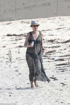 Wendi Deng, 49 wows in sheer kaftan dress on St Barts beach jaunt