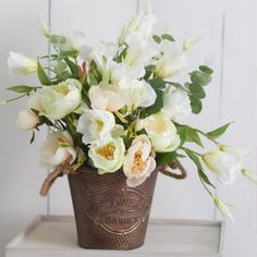 Our rose bouquets look gorgeous in the little rust textured bucket!