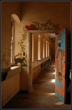 ST JOHNS ASYLUM aka LINCOLNSHIRE COUNTY PAUPER LUNATIC ASYLUM, Bracebridge Heath, Lincolnshire, England. The entrance to the childrens ward, paintings of cats & flowers around the door frame. August 2009