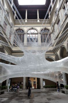 A Super-Sized Cocoon Made of Packing Tape That You Can Curl Up In. By Numen/For Use