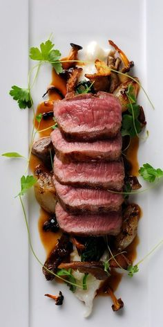 Food - This exceptional lamb loin recipe from Chris Horridge features a wonderful combination of elements, with blushing lamb served on a bed of creamy Parmesan risotto and wilted spinach, finished off with roast shallots, wild mushrooms and olives. Lamb Recipes, Meat Recipes, Gourmet Recipes, Cooking Recipes, Healthy Recipes, Gourmet Desserts, Plated Desserts, Gourmet Foods, Easy Cooking