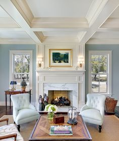 Love how they tied the coffered ceiling into the fireplace. This is a very crisp, clean look!