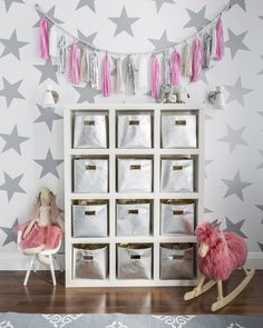 Playroom Organization Perfection! Plus, we love the tassel garland accent. {click for sourcing}