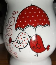 Red and white birds under umbrella painted rock