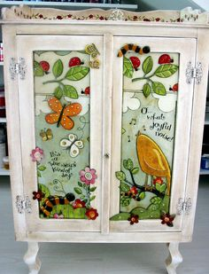 little cupboard with birds and cats