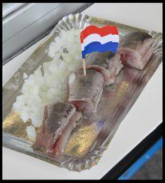 Hollandse nieuwe, rauwe haring met uitjes