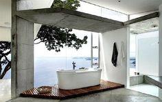 Perfect Bathroom Gigantic Tub   Modern bathroom with large bathtub on wooden slats looking out a floor ...