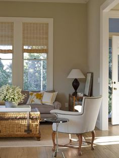 A living room bathed cream, taupe, and other shades of neutral deliciousness.