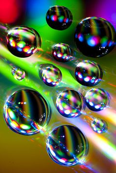 Rainbow Color Explosion in Water Drops by TxPilot, via Flickr. Macro of water droplets on the reading side of compact disc.