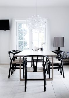 Wishone chair by Hans J Wegner from Carl Hansen and Essay dining table by Ceclie Manz from Fritz Hansen
