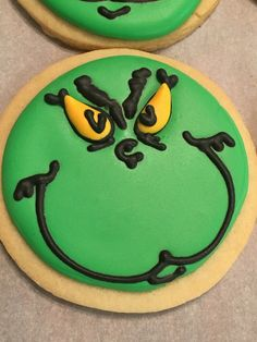 My first ever Grinch cookies! They are scratch sugar cookies that I made for a Christmas cookie exchange. I used royal icing transfers for the eyes. Free handed the rest.