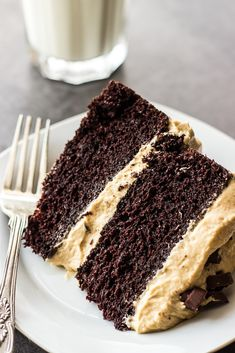 A decadent dessert, this Chocolate Layer Cake with Creamy Peanut Butter Frosting NEVER disappoints!