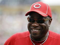 Cincinnati Reds manager Dusty Baker smiles as his team warms up before a  spring training baseball 9285b6c775ea