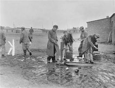 Survivors get water at one of the community pumps in the newly liberated Woebbelin concentration camp.