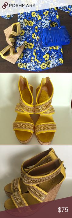 ☀️Amazing Tory Burch Wedges☀️ You're walking on sunshine in these amazing Tory Burch yellow leather with gold detail cork wedges. They are super comfortable to wear all day and dance all night! Pair with my Kate Spade Skirt, DVF dress, Tibi Dress and create your own bundle! Previously loved, but in great shape! Open to offers- but no trades! Happy Poshing! 💗💗 Tory Burch Shoes Wedges