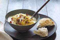 Our Slow-Cooker Loaded Baked Potato Soup is the ultimate comfort food.  Top it off with crumbled bacon, shredded cheese, sour cream and chives.