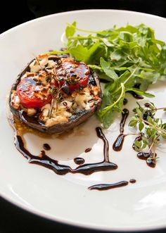 Oven grilled Portobello stuffed with feta cheese, cherry tomatoes, garlic, butter, and thyme. Served arugula salad and drizzled balsamic glaze.