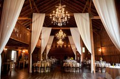 Chandeliers and opulent white fabric decor at the Barns at Wesleyan Hills! Powerstation Events, August 2015