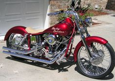 Here is something to look at! It's a Red custom Harley Davidson motorcycle. #www.nycfitnessfamilfinds.net