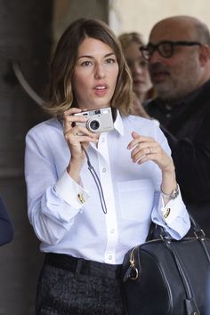 Director Sofia Coppola takes pictures as she attends the 67th Venice Film Festival on September 3, 2010 in Venice, Italy.