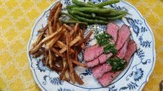 From Nonnie's Kitchen - Steak on the grill with chimichurri sauce.  Find the recipe for chimichurri sauce here.