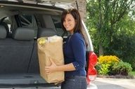 Help someone load or unload their groceries