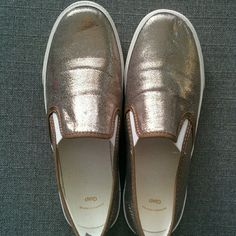 """Gap metallic slip ons Gap metallic slip ons. I LOVE these but they are just too tight on the top of my foot. Otherwise they are a comfortable shoe. Never worn except in my house trying to make them fit me :'( Gorgeous champagne/tan color. """"Flaw"""" shown in 4th pic, should come off just haven't tried to yet, bought like that. Size 7. GAP Shoes Sneakers"""