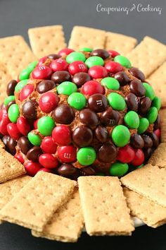 A gingerbread twist on a traditional dessert cheeseball, topped with Gingerbread M&M's it's the perfect holiday dessert! This looks interesting Dessert Dips, Party Desserts, Holiday Baking, Christmas Desserts, Holiday Treats, Christmas Treats, Christmas Baking, Holiday Recipes, Dessert Recipes