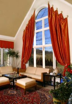 rods for arched window covering | Arched Window Treatments with Red Curtains and Rug
