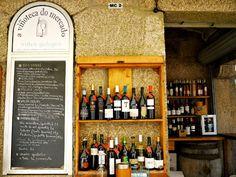Local wines at the vinoteca inside the Mercado de Abastos in Santiago de Compostela. A glass of local wine starts at around 2 EUR.