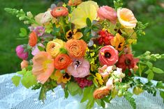 Wedding Flowers from Springwell: Peach and Coral Ranunculus and Poppies
