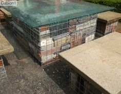 close up of glass topped gabion with old brick rubble infill http://www.gabion1.co.uk