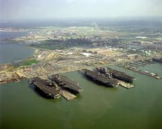 America John F. Kennedy Nimitz and Eisenhower in a row at Naval Station Norfolk, Virginia. America is in feet of water in the Atlantic from a test and JFK is at Philadelphia awaiting her fate. Us Navy, Navy Day, John F Kennedy, Navy Military, Military Life, American Aircraft Carriers, Naval Station Norfolk, Uss America, Navy Carriers
