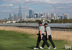 Branden Grace and Louis Oosthuizen of the International Team walk up the 14th fairway on day two of the Presidents Cup on September 29,…
