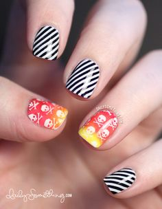 Thumb & Ring Fingers Base Color: OPI Alpine Snow Stamping Plate: Cheeky CH49 (skulls) Stamping Colors: Konad Special Polish Yellow and Cool Red, and Sally Hansen Insta-Dri in Sonic Boom (orange)  The gradient stamping was done with three colors, similar to how I stamped in this video.  Pointer, Middle, & Pinky Fingers Base Color: OPI Black Onyx Stamping Plate: Cheeky Jumbo Plate N Stamping Colors: Konad Special Polish White